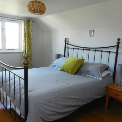 Bedroom with iron bedstead, Habitat cotton grey bedlinen