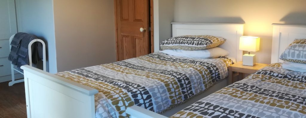 View of bedroom at Whitegate Cottage with Lotta Jansdotter bedding