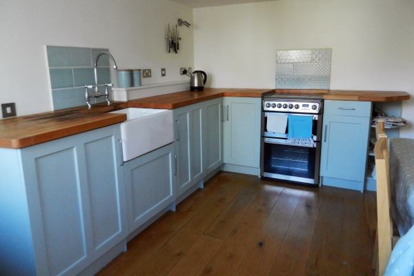 Kitchen, hand built wooden with oak flooring cabinets painted and wooden word surface geometric tiles